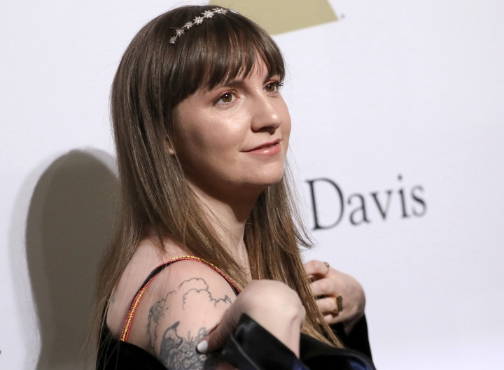 "FILE - In this Feb. 11, 2017 file photo, Lena Dunham attends the Clive Davis and The Recording Academy Pre-Grammy Gala in Beverly Hills, Calif. In a new New York Times report, Dunham claims that she warned Hillary Clinton's communications director about Harvey Weinstein's behavior. She told the Times that when she worked with the Clinton presidential campaign last year, she tried to warn that Weinstein was ""a rapist, and this is going to come out at some point."" (Photo by Rich Fury/Invision/AP, File)"