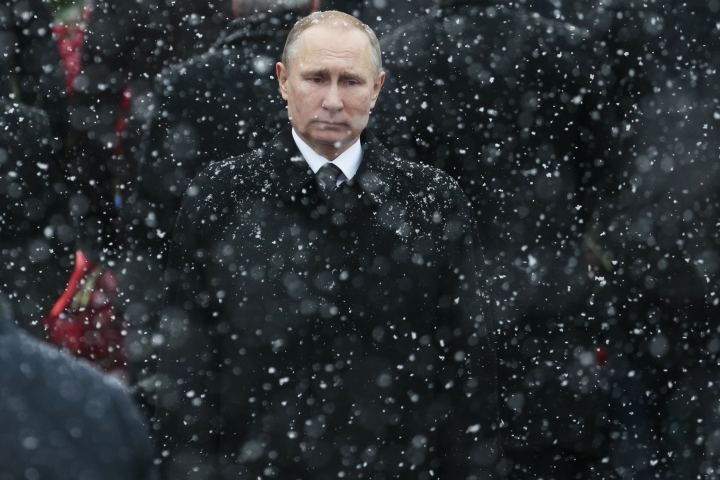FILE - In this file photo taken on Thursday, Feb. 23, 2017, Russian President Vladimir Putin attends a wreath-laying ceremony at the Tomb of the Unknown Soldier in Moscow, Russia. Putin says he will seek re-election in next March's election. (AP Photo/Ivan Sekretarev, File)
