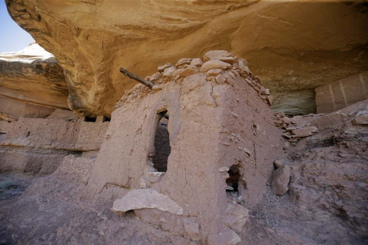 """FILE - This July 15, 2016, file photo, shows the """"Moonhouse"""" in McLoyd Canyon which is part of Bears Ears National Monument, near Blanding, Utah. President Donald Trump's rare move to shrink two large national monuments in Utah triggered another round of outrage among Native American leaders who vowed to unite and take the fight to court to preserve protections for lands they consider sacred. Trump decided to reduce Bears Ears — created last December by President Barack Obama — by about 85 percent and Grand Staircase-Escalante — designated in 1996 by President Bill Clinton — by nearly half. (AP Photo/Rick Bowmer, File)"""