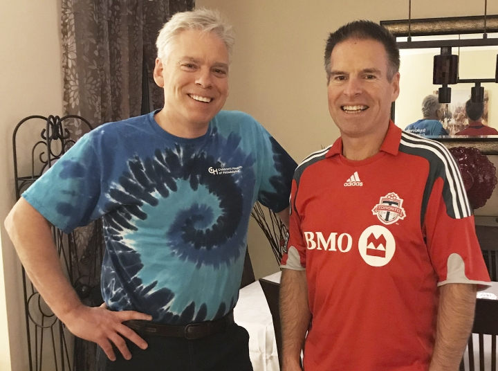 """This Saturday, Dec. 2, 2017 photo provided by Jay Konduros, left, shows him and his brother, Bill, at Jay's home in Cambridge, Ontario, Canada. The brothers, who have hemophilia, were involved in a gene therapy study for their condition. Before the treatment, """"Even something as innocuous as reaching over your head to get something out of a closet, or reaching down to tie a shoe"""" could trigger trouble, Bill said. (Courtesy Jay Konduros via AP)"""