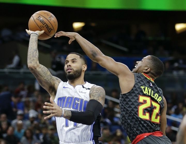 Atlanta Hawks guard Isaiah Taylor (22) deflects a shot attempt by Orlando Magic's D.J. Augustin, left, during the first half of an NBA basketball game, Wednesday, Dec. 6, 2017, in Orlando, Fla. (AP Photo/John Raoux)