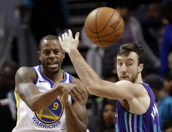 Golden State Warriors' Andre Iguodala (9) passes the ball past Charlotte Hornets' Frank Kaminsky during the first half of an NBA basketball game in Charlotte, N.C., Wednesday, Dec. 6, 2017. (AP Photo/Chuck Burton)