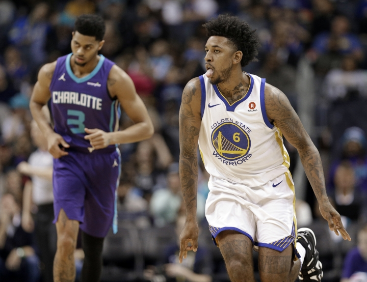 Golden State Warriors' Nick Young (6) reacts to making a basket against Charlotte Hornets' Jeremy Lamb (3) during the first half of an NBA basketball game in Charlotte, N.C., Wednesday, Dec. 6, 2017. (AP Photo/Chuck Burton)