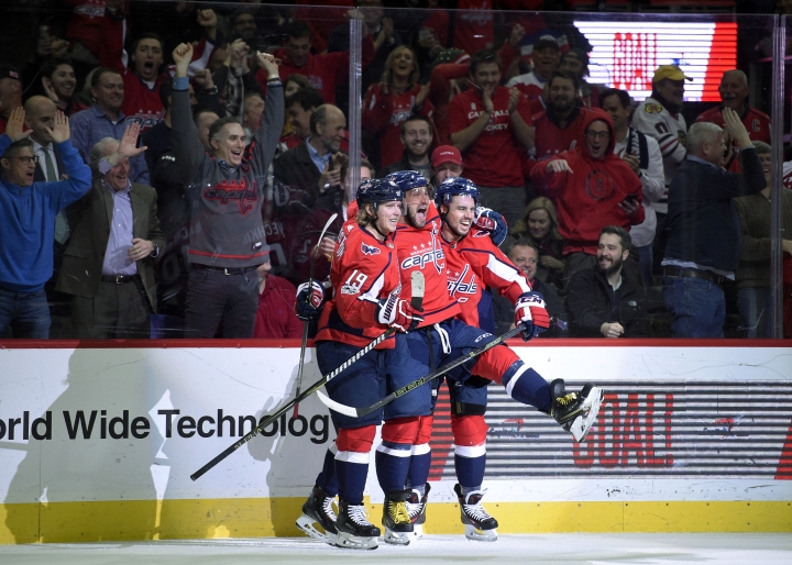 Washington Capitals left wing Alex Ovechkin, center, of Russia, celebrates his goal with center Nicklas Backstrom (19), of Sweden, and Washington Capitals defenseman Matt Niskanen, right, during the first period of an NHL hockey game against the Chicago Blackhawks, Wednesday, Dec. 6, 2017, in Washington. (AP Photo/Nick Wass)