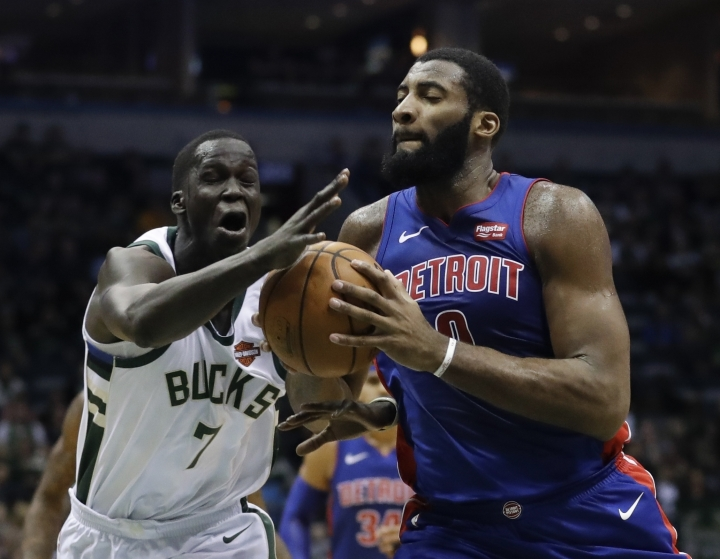 Milwaukee Bucks' Thon Maker fouls Detroit Pistons' Andre Drummond during the first half of an NBA basketball game Wednesday, Dec. 6, 2017, in Milwaukee. (AP Photo/Morry Gash)
