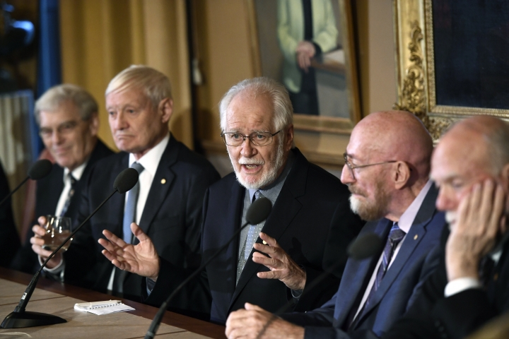 From left, Richard Henderson, Nobel Laureate in Chemistry, Joachim Frank, Nobel Laureate in Chemistry, Jacques Dubochet, Nobel Laureate in Chemistry, Kip Thorne, Nobel Laureate in Physics and Barry Barish, Nobel Laureate in Physics speak during a press conference at the Royal Academy of Science in Stockholm, Thursday Dec. 7, 2017. (Pontus Lundahl/TT News Agency via AP)