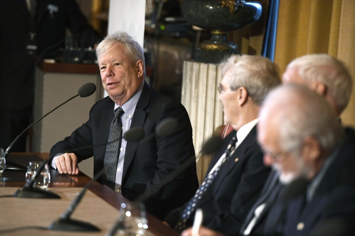 From left, Richard Thaler, Nobel Laureate in Economics, speaks during a press conference with Richard Henderson, Nobel Laureate in Chemistry, Joachim Frank, Nobel Laureate in Chemistry and Jacques Dubochet, Nobel Laureate in Chemistry at the Royal Academy of Science in Stockholm, Thursday Dec. 7, 2017. (Pontus Lundahl/TT via AP)