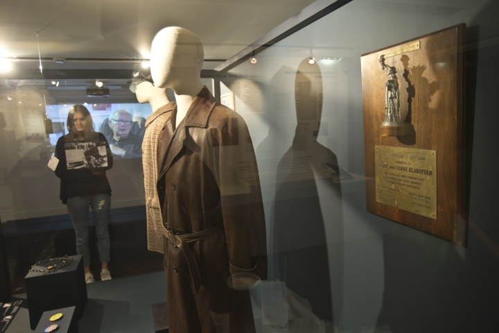 """In this photo taken on Tuesday, Dec. 5, 2017, the coats of French Nazi hunter Serge Klarsfeld are displayed at the Shoah Memorial in Paris, France. The story of Nazi hunters Beate and Serge Klarsfeld is well known in many ways _ and has even spawned a Hollywood movie. Yet, not all has been told of the steely married couple's quest to bring down some of the Third Reich's most infamous villains including Klaus Barbie, the so-called """"Butcher of Lyon."""" Paris' Shoah Memorial is this week hosting the world's first ever exhibit into their story _ called """"Beate and Serge Klarsfeld, Fighters for Memory."""" (AP Photo/Michel Euler)"""