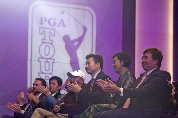 Greg Gilligan, right, PGA Tour's Greater China managing director, and Hong Li, second from right, co-founder and Chairwomen of Shankai Sports, attend a signing ceremony for their joint partnership and management of the PGA Tour China series for 20 years from 2018 at a hotel in Beijing Thursday, Dec. 7, 2017. Shankai, a Beijing-based firm, says its new venture is receiving a 300 million yuan ($45 million) investment from Yao Capital, a private equity firm co-founded by former Houston Rockets player Yao Ming, and U.S.-based IDG Capital. (AP Photo/Ng Han Guan)