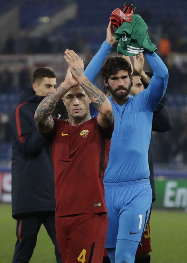Roma goalkeeper Alisson, right and Roma's Radja Nainggolan celebrate their victory at the end of the group C Champions League soccer match between Roma and Qarabag at the Stadio Olimpico in Rome, Italy, Tuesday, Dec. 5, 2017. (AP Photo/Alessandra Tarantino)