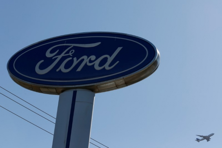 FILE PHOTO: An airplane flies above a Ford logo in Colma, California, U.S., October 3, 2017. REUTERS/Stephen Lam/File Photo