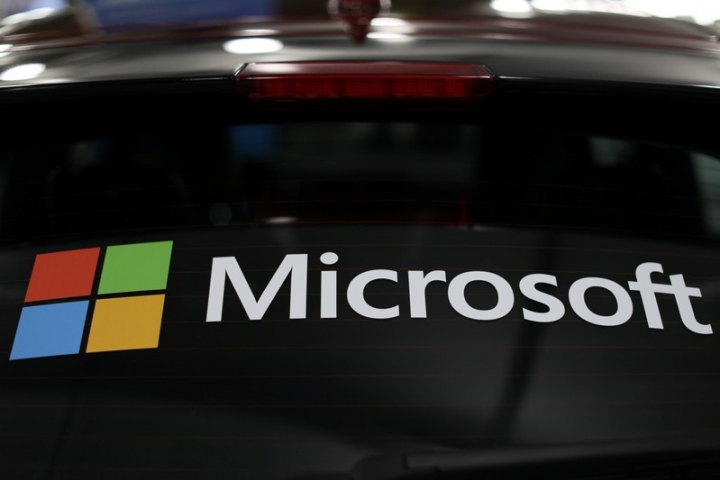 The Microsoft logo is shown on an electric car at the Auto Show in Los Angeles, California, U.S., November 28, 2017.      REUTERS/Mike Blake