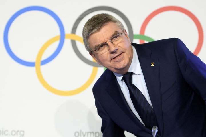 International Olympic Committee (IOC) president Thomas Bach, from Germany speaks during a media conference after the second day of the executive board meeting of the International Olympic Committee (IOC), in Lausanne, Switzerland, Wednesday, Dec. 6, 2017. The International Olympic Committee on Tuesday banned the Russian Olympic team from the upcoming South Korea games as punishment for doping violations at the 2014 Sochi Olympics.(Laurent Gillieron/dpa via AP)