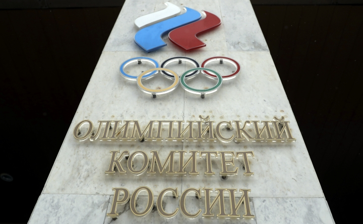 The logo of the Russian Olympic Committee is mounted at the entrance of the head office in Moscow, Russia, Wednesday, Dec. 6, 2017. The International Olympic Committee has barred the Russian team from competing at the Winter Olympics in Pyeongchang in February over widespread doping at the last Winter Games in 2014. (AP Photo/Pavel Golovkin)