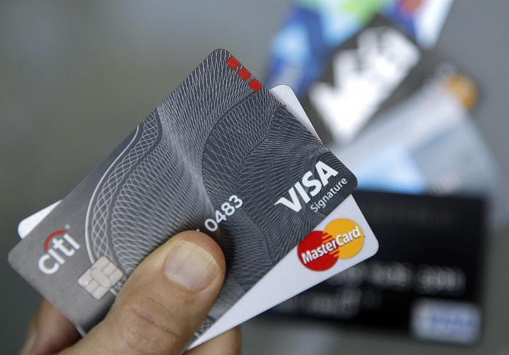 FILE - In this June 15, 2017, file photo, credit cards are displayed in Haverhill, Mass. On Thursday, Dec. 7, 2017, the Federal Reserve releases its October report on consumer borrowing. (AP Photo/Elise Amendola, File)