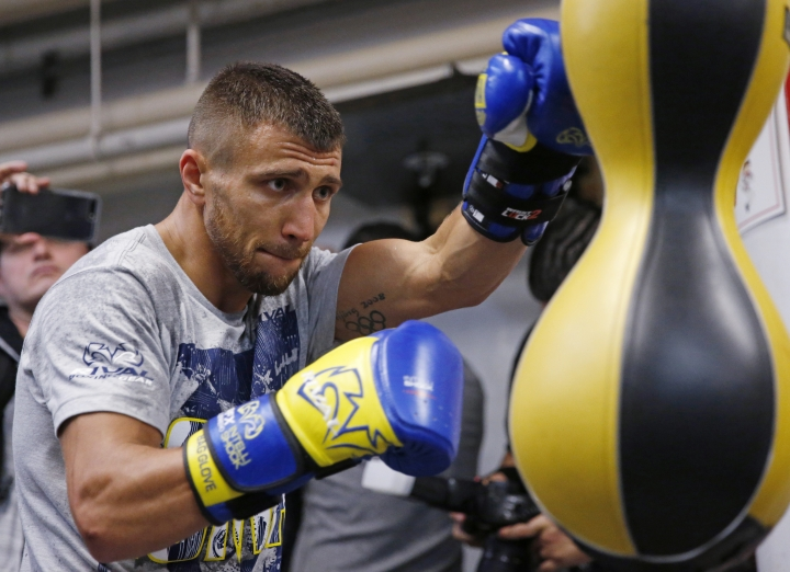 Vasyl Lomachenko, of Ukraine, punches a bag during a workout at a Manhattan boxing gym Wednesday, Dec. 6, 2017, in New York, while preparing for his Saturday WBO super featherweight title fight against Guillermo Rigondeaux. (AP Photo/Kathy Willens)