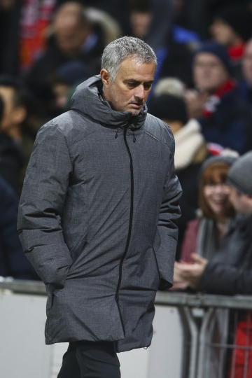 Manchester United's head coach Jose Mourinho leaves the field after the first time of the Champions League group A soccer match between Manchester United and CSKA Moscow in Manchester, England, Tuesday, Dec. 5, 2017. (AP Photo/Dave Thompson)