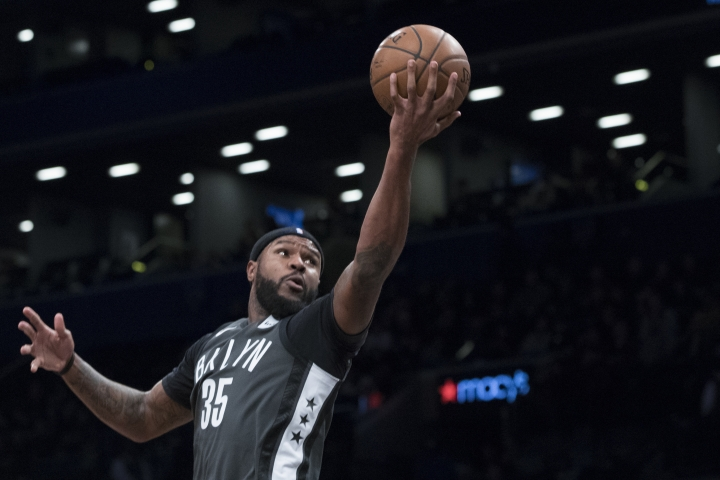 FILE - In this Dec. 2, 2017, file photo, Brooklyn Nets forward Trevor Booker (35) goes to the basket during the first half of an NBA basketball game against the Atlanta Hawks in New York. A person familiar with the deal says the Philadelphia 76ers are set to trade beleaguered center Jahlil Okafor to the Nets along with guard Nik Stauskas and a 2019 second-round draft pick for forward Booker. (AP Photo/Mary Altaffer, File)
