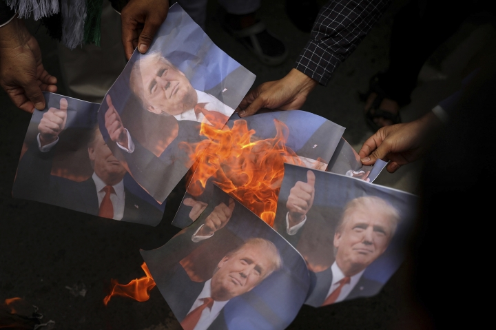 Muslim men burn portraits of U.S. President Donald Trump during a rally against his decision to recognize Jerusalem as Israel's capital in Banda Aceh, Indonesia, Friday, Dec. 8, 2017. Hundreds of people across the most populous Muslim country staged protests Friday against Trump administration's policy shift on the contested city. (AP Photo/Heri Juanda)