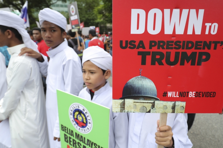 Muslim students protest during a protest outside the U.S. Embassy in Kuala Lumpur, Malaysia, Friday, Dec. 8, 2017. Malaysian Muslims, including members of the ruling party, hold protest outside U.S. Embassy over Washington's controversial move to recognize Jerusalem as Israel's capital. (AP Photo/Vincent Thian)