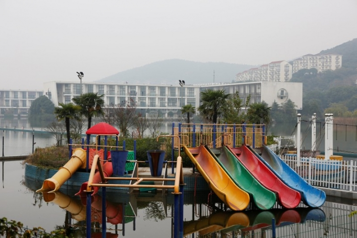 An unused and rusting playground outside a hotel on the shores of Lake Tai, is pictured in Yixing city, where the local government is working to develop the local tourism industry, Zhejiang province, China November 14, 2017. REUTERS/Christian Shepherd