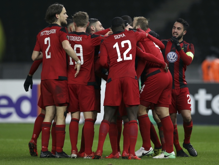 Ostersund's players celebrate the opening goal during the Europa League Group J soccer match between Hertha BSC and Ostersunds FK in Berlin, Germany, Thursday, Dec. 7, 2017. (AP Photo/Michael Sohn)