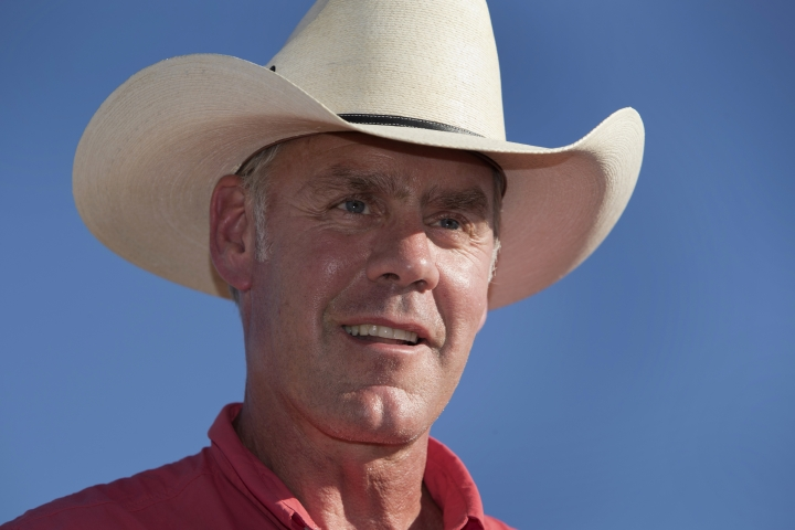 FILE - In this July 30, 2017 file photo, U.S. Interior Secretary Ryan Zinke speaks during a news conference near Gold Butte National Monument in Bunkerville, Nev. Zinke and outdoor retail giant Patagonia are trading harsh words over the Trump administration's plans to shrink several national monuments, an opening salvo in an imminent legal battle that could be waged for years. A barrage of lawsuits is expected by groups looking to block President Donald Trump's order on Monday, Dec. 4, 2017, drastically reducing Utah's Bears Ears and Grand Staircase-Escalante National Monuments. (Steve Marcus/Las Vegas Sun via AP, File)