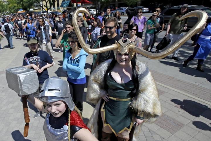 "FILE- In this Sept. 4, 2017, file photo, Jessica Nowan, left and Caitlin Grandstaff, right, stand in line for the Salt Lake Comic Con at the Salt Palace Convention Center, in Salt Lake City. There is a court battle between rival pop-culture conventions in California and Utah who are battling over rights to use the phrase ""comic con."" (AP Photo/Rick Bowmer, File)"
