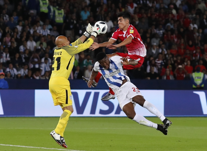 Mexico's Pachuca goalkeeper Oscar Perez, left, makes a save in front of Morocco's Wydad Athletic Club Achraf Bencharki, right, during the Club World Cup soccer match between Pachuca and Wydad Athletic Club at Zayed sport city in Abu Dhabi, United Arab Emirates, Saturday, Dec. 9, 2017. (AP Photo/Hassan Ammar)