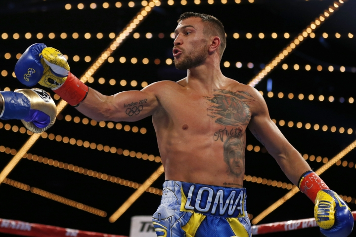 Vasyl Lomachenko, of Ukraine, reacts toward Guillermo Rigondeaux at the end of the second round of a WBO junior lightweight title boxing match Saturday, Dec. 9, 2017, in New York. Lomachenko won the bout. (AP Photo/Adam Hunger)