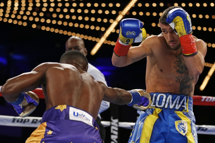 Vasyl Lomachenko, of Ukraine, avoids a punch by Guillermo Rigondeaux during the first round of a WBO junior lightweight title boxing match Saturday, Dec. 9, 2017, in New York. (AP Photo/Adam Hunger)