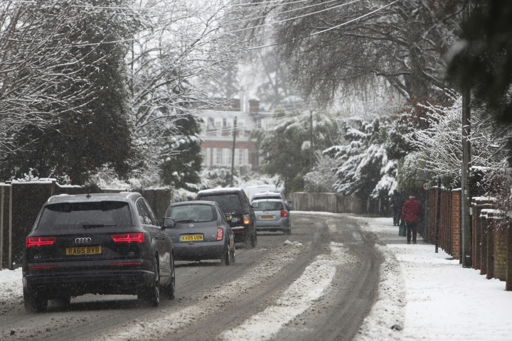 The snow covered streets in Bisham, England, as heavy snowfall across parts of the UK is causing widespread disruption, Sunday Dec. 10, 2017. Snowfall has caused roads to close and grounding some flights at various airports. (Steve Parsons/PA via AP)