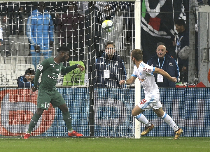 Marseille's Valere Germain, right, reacts after scoring, during the League One soccer match between Marseille and Saint-Etienne, at the Velodrome stadium, in Marseille, southern France, Sunday, Dec. 10, 2017. (AP Photo/Claude Paris)