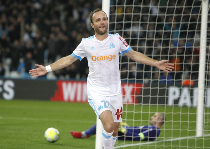 Marseille's Valere Germain celebrates after scoring his second goal during the League One soccer match between Marseille and Saint-Etienne, at the Velodrome stadium, in Marseille, southern France, Sunday, Dec. 10, 2017. (AP Photo/Claude Paris)