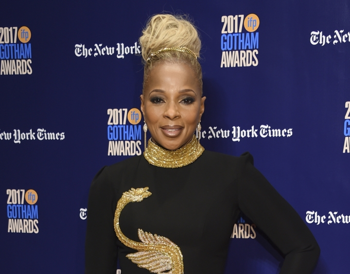 """FILE - In this Nov. 27, 2017 file photo, Mary J. Blige arrives at the 27th annual Independent Film Project's Gotham Awards in New York. Blige was nominated for two Golden Globe awards on Monday, Dec. 11, 2017, including one for best original song for """"Mighty River,"""" featured in """"Mudbound."""" (Photo by Evan Agostini/Invision/AP, File)"""