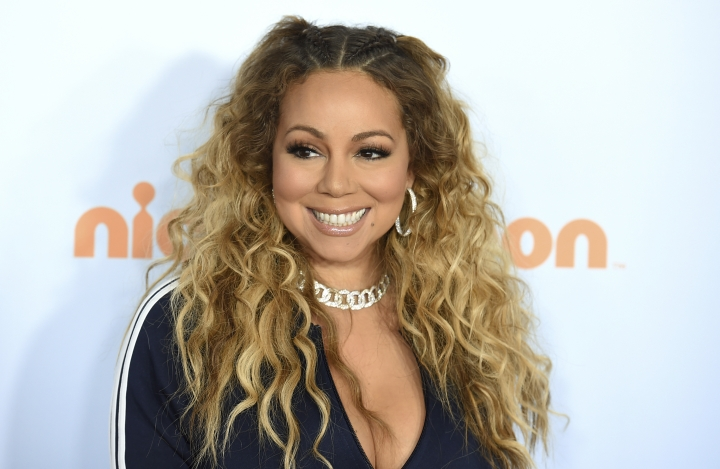 """FILE - In this March 11, 2017 file photo, Mariah Carey arrives at the Kids' Choice Awards in Los Angeles. Carey was nominated for a Golden Globe for best original song on Monday, Dec. 11, 2017, for """"The Star,"""" featured in the animated film of the same name. (Photo by Jordan Strauss/Invision/AP, File)"""