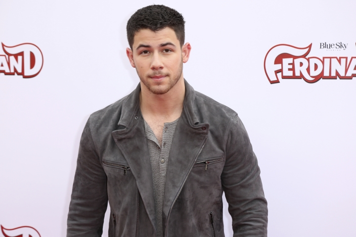 """FILE - In this Dec. 10, 2017 file photo, singer Nick Jonas arrives at the LA Premiere of """"Ferdinand"""" in Los Angeles. Jonas was nominated for a Golden Globe on Monday, Dec. 11, 2017 for his song """"Home,"""" which is featured in the film. (Photo by Willy Sanjuan/Invision/AP, File)"""