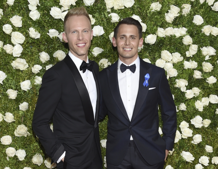 """FILE - In this June 11, 2017 file photo, Justin Paul, left, and Benj Pasek arrive at the 71st annual Tony Awards in New York. Paul and Pasek were nominated for a Golden Globe award for best original song for """"This Is Me,"""" featured in """"The Greatest Showman."""" (Photo by Evan Agostini/Invision/AP, File)"""