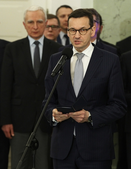 Polish Prime Minister Mateusz Morawiecki speaks after receiving his nomination from President Andrzej Duda during ceremony at the Presidential Palace in Warsaw, Poland, Monday, Dec. 11, 2017. Morawiecki is to focus on developing Poland's economy and improving the government's image abroad. (AP Photo/Czarek Sokolowski)