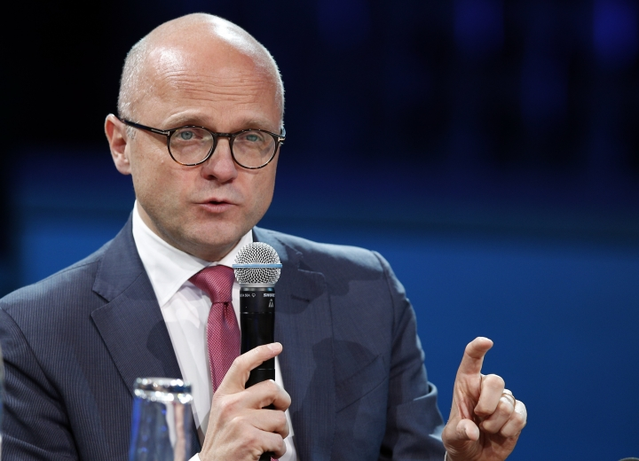 Norway's Environment Minister Vidar Helgesen attends a conference at the One Planet Summit, in Boulogne-Billancourt, near Paris, France, Tuesday, Dec. 12, 2017. World leaders, investment funds and energy magnates promised to devote new money and technology to slow global warming at a summit in Paris that President Emmanuel Macron hopes will rev up the Paris climate accord that U.S. President Donald Trump has rejected. (AP Photo/Christophe Ena)