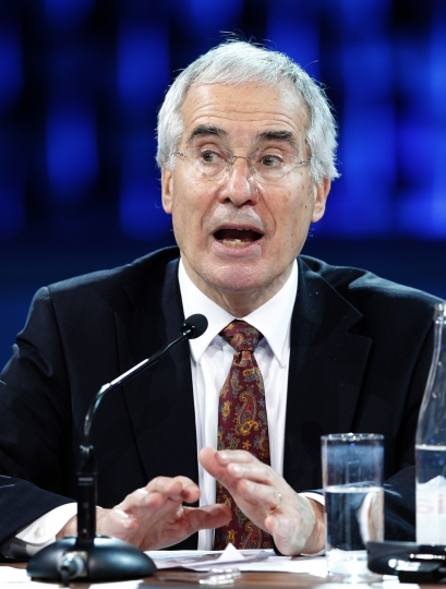 Nicholas Stern, chairman of the Grantham Research Institute on Climate Change attends a conference at the One Planet Summit, in Boulogne-Billancourt, near Paris, France, Tuesday, Dec. 12, 2017. World leaders, investment funds and energy magnates promised to devote new money and technology to slow global warming at a summit in Paris that President Emmanuel Macron hopes will rev up the Paris climate accord that U.S. President Donald Trump has rejected. (AP Photo/Christophe Ena)