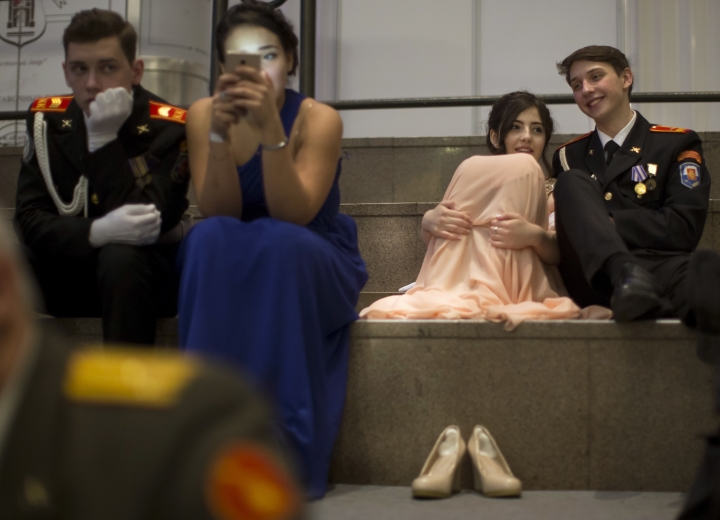Military school students rest during their annual ball in Moscow, Russia, Tuesday, Dec. 12, 2017. The ball attracts the youth from all over Russia. (AP Photo/Alexander Zemlianichenko)