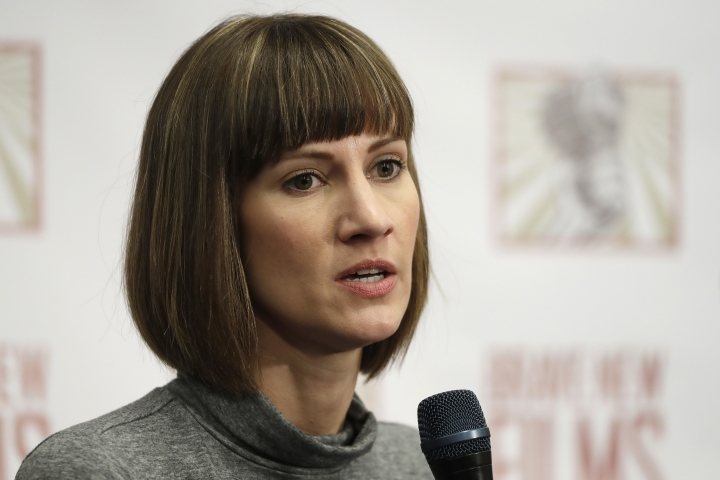 Rachel Crooks speaks at a news conference, Monday, Dec. 11, 2017, in New York to discuss her accusations of sexual misconduct against Donald Trump. The women, who first shared their stories before the November 2016 election, called for a congressional investigation into Trump's alleged behavior. (AP Photo/Mark Lennihan)