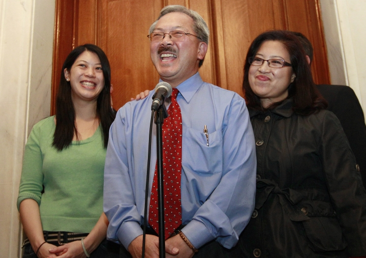 FILE - In this Nov. 9, 2011, file photo,San Francisco Mayor Ed Lee, center, speaks at a news conference next to his wife Anita, right, and his daughter Brianna, left, outside of his office at City Hall in San Francisco. The San Francisco Chronicle reported that Lee died early Tuesday, Dec. 12, 2017. He was 65. (AP Photo/Jeff Chiu, File)