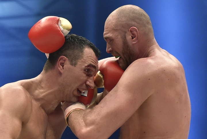 FILE - In this file photo dated Sunday, Nov. 29, 2015, Ukraine's Wladimir Klitschko and Britain's Tyson Fury, right, exchange blows in a world heavyweight title fight as Fury wins Klitschko's WBA, IBF, WBO and IBO belts in the Esprit Arena in Duesseldorf, western Germany. It is announced Tuesday Dec. 12, 2017, that Tyson Fury is free to box again after receiving a backdated two-year ban for an anti-doping violation. Fury has not fought since beating Wladimir Klitschko in November 2015. (AP Photo/Martin Meissner, FILE)