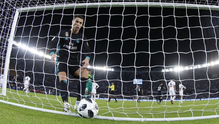 Real Madrid's Cristiano Ronaldo runs to catch the ball into the net after his teammate Gareth Bale scored the winning goal during the Club World Cup semifinal soccer match between Real Madrid and Al Jazira Club at Zayed sport city in Abu Dhabi, United Arab Emirates, Wednesday, Dec. 13, 2017. Real Madrid won 2-1. (AP Photo/Hassan Ammar)