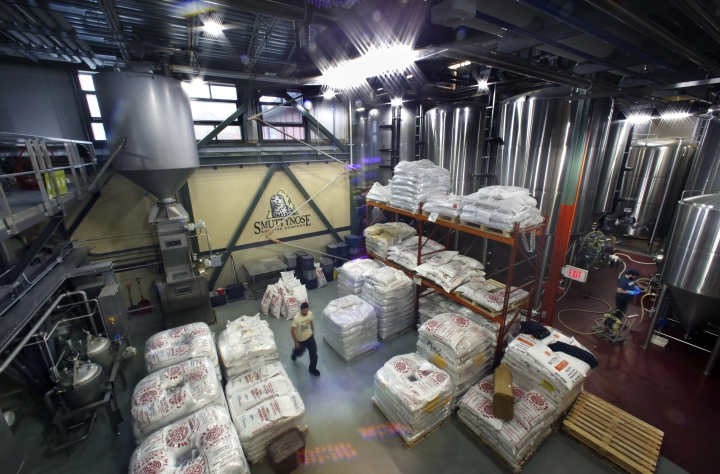 This Thursday, Nov. 16, 2017 photo shows energy efficient motion activated LED lights, along with window light, that illuminate the Smuttynose Brewery in Hampton, N.H. The brewhouse is taking advantage of special programs to use new technology to reduce its carbon footprint. (AP Photo/Robert F. Bukaty)