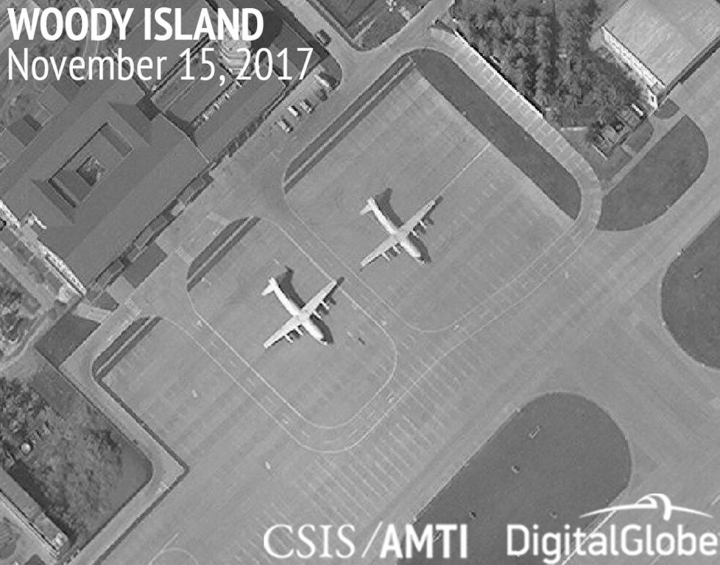 This image provided by CSIS Asia Maritime Transparency Initiative/DigitalGlobe shows a satellite image of Woody Island in the Paracel island chain in the South China Sea taken Nov. 15, 2017, and annotated by the source, showing two Chinese Y-8 military transport aircraft. The Washington-based Asia Maritime Transparency Initiative says China has undertaken new deployments of military aircraft on the island in recent weeks. On other outposts in the disputed South China Sea has conducted major construction work during 2017.(CSIS Asia Maritime Transparency Initiative/DigitalGlobe via AP)
