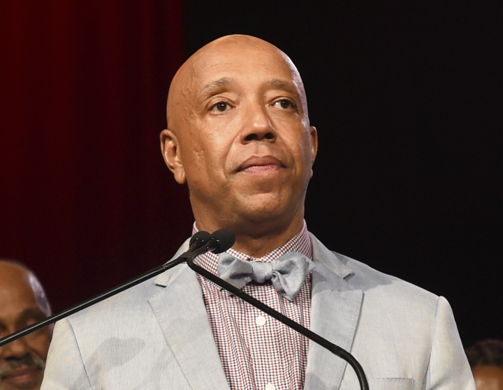 "FILE - In this July 18, 2015 file photo, Russell Simmons speaks appears at the RUSH Philanthropic Arts Foundation's Art for Life Benefit in Water Mill, N.Y. Three women have told the New York Times that music mogul Russell Simmons raped them. Simmons, in a statement to the paper, vehemently denied what he called ""these horrific accusations,"" saying all his relations have been consensual. (Photo by Scott Roth/Invision/AP, File)"