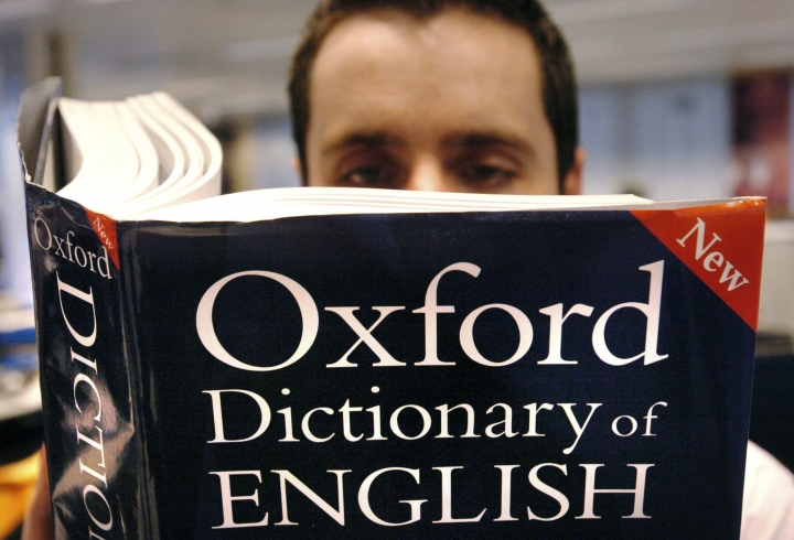 "FILE - In this March 14, 2007 file photo, a man reads a copy of the Oxford Dictionary of English. Oxford Dictionaries is recognizing the power of the millennial generation with its 2017 word of the year: youthquake. Oxford lexicographers say there was a fivefold increase in use of the term between 2016 and 2017. It is defined as ""a significant cultural, political, or social change arising from the actions or influence of young people."" (Ian Nicholson/PA via AP, File)"